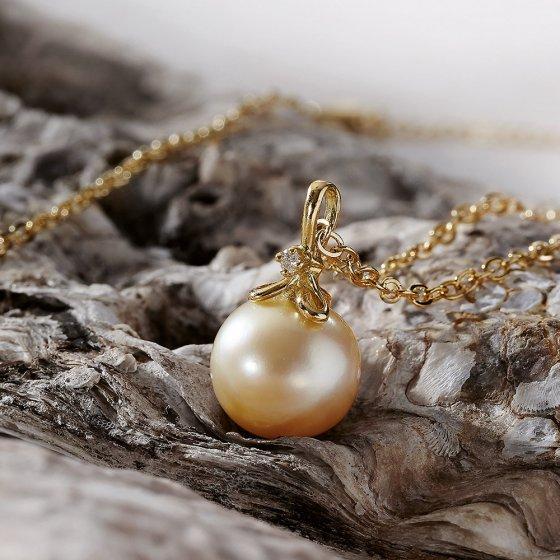 Smykke: gullperle med diamant