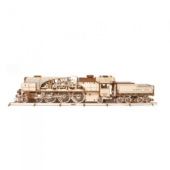 Damplokomotivmodell i tre med vogn